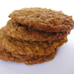 Image of four Kamut Oatmeal Cookies stacked on top of each other on a white background.