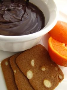 Rich and Dark Chocolate Ganache with Cookies and Clementine