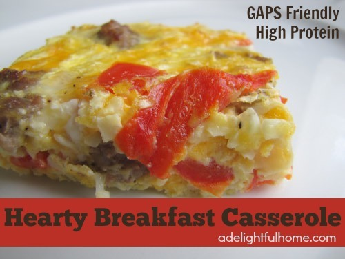 "Image of a serving of an egg casserole on a white plate. Text overlay says, ""Hearty Breakfast Casserole""."