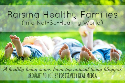 """Photo of barefoot children laying in the grass. Text overlay says, """"Raising Healthy Families in a Not-So-Healthy World""""."""