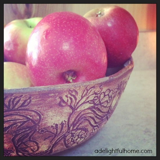 apples in carved bowl