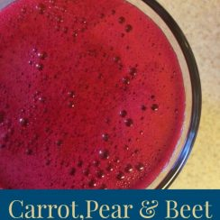 "Bird's eye view of a glass of fresh pressed juice. Text overlay says, ""Carrot, Pear, and Beet Juice""."