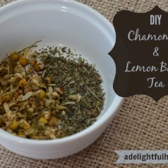 "Image of a ramekin filled with loose leaf tea. Text overlay says, ""DIY Chamomile & Lemon Balm Tea""."