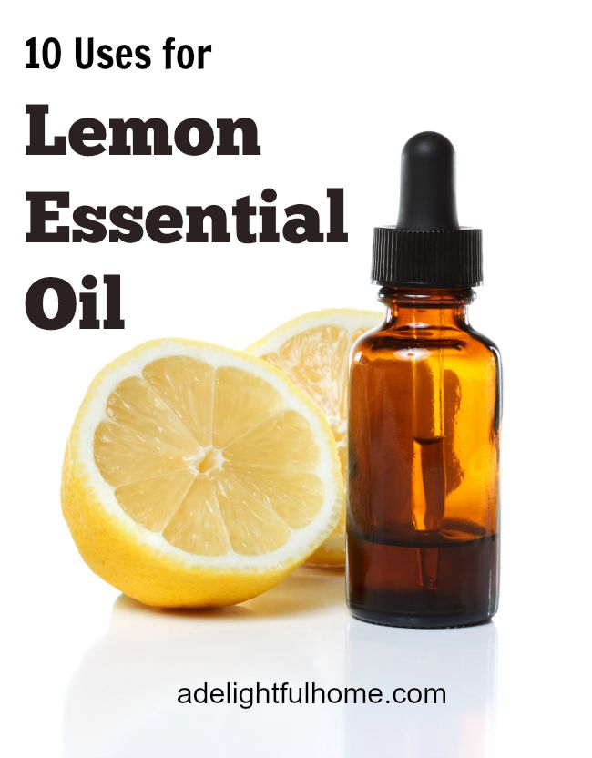 "A fresh lemon cut in half sitting next to an amber dropper bottle. Text overlay says, ""Lemon Essential Oil""."