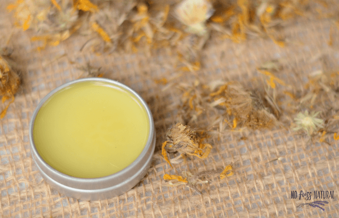 metal tin with homemade arnica salve