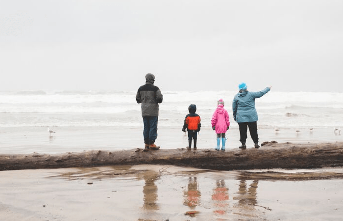 family looking out at wintery ocean