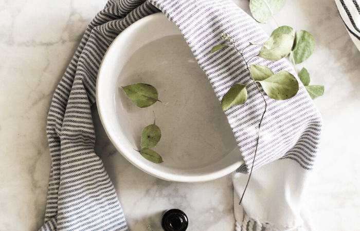 bowl with water and towel for facial steam