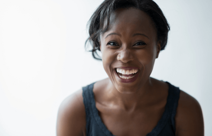 woman laughing for stress relief