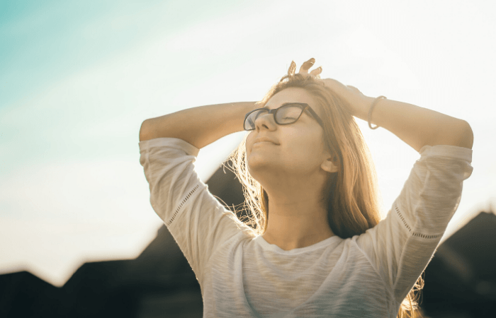 women outside breathing air for stress relief